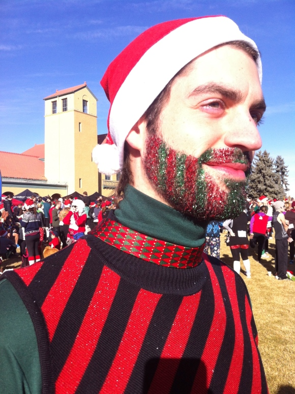 Nick and his glitter-tastic beard impressed us today at the Ugly Sweater 5K fun run in City Park.  Nick, who is originally from Idaho, has been known to glitterize and otherwise accessorize his beard for multiple occasions, and he didn't disappoint today; among the many bearded dudes (and ugly sweaters) in the park, he stood out above the rest. He's had his beard for the better part of the past four years, and we sure hope he continues to glitterize it for years to come!
