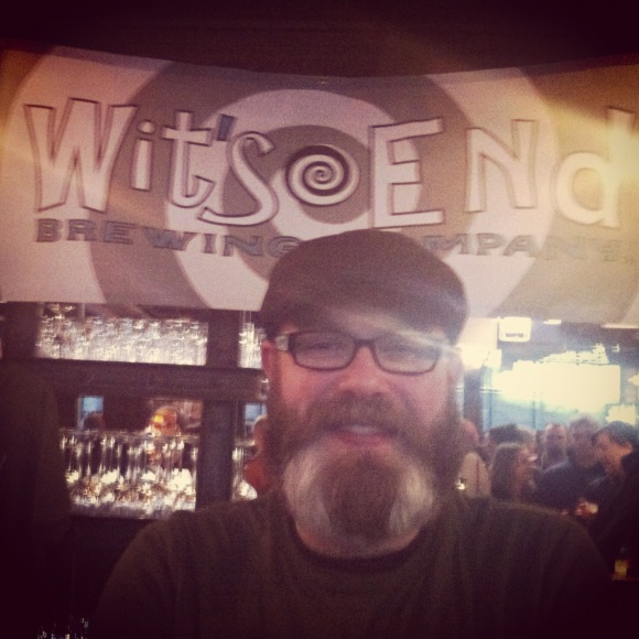 "We met Scott, self-professed Owner, Brewer, and Dream at Wits End Brewing Company in Denver at the Beer and Bacon Fest at Mile High Station in Denver on Sunday. Scott's been growing his impressive beard since August, and when asked if the coloration was natural his response was ""Do I look like a guy who'd dye his beard?"" It's that amazing natural talent we love and appreciate here at Beards of Denver. Originally from Seattle, Scott's been in Denver about 11 years and we highly recommend going to Wits End to say hi to Scott, admire his beard, and sample Wits End's amazing coffee beer--you won't be disappointed in the coffee or the beard!"
