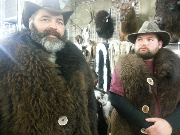 "This duo could quite possibly be the manliest, beardest most mountain man-ish find yet! Meet Blair (papa beard) and Jed (son beard). It came as no surprise to us that these beards were raised in a colder climate. They moved from Minnesota to Colorado just under 2 years ago. When asked why, Blair responded ""I take it you've never been to Minnesota in the winter"". With beards like this we may have to move! This pair has learned that growing beards together creates a special father/son bond that clearly the women of the house don't understand. Blair's nickname from his oldest daughter is 'chia pet' (we think 'bear fighter' is a better fit). His wife does offer her support; she's just anxiously awaiting a trim. Nice work, men!"