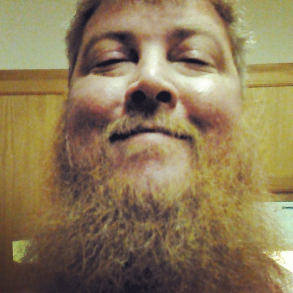 "Jon gives a whole new meaning to the term 'Bad Ass Beard'. This self described ""shady Broncos orange"" beard has made one hell of a come back. His poor chin was temporarily naked while Jon kicked the shit out of cancer. Two years later, the beard is back and better than ever! Thanks for sharing, Jon! A beard that can take down A.L.L is one beard you don't want to mess with."