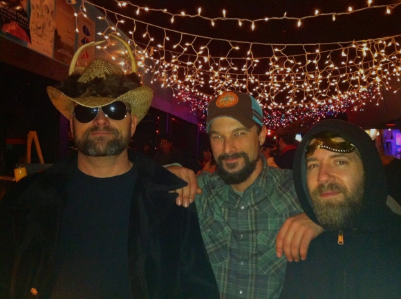 What better night than Valentine's day to meet a bearded triple-threat? Meet Tim, Clint, and Matt (L-R) who we happened upon at the Bonnie and the Beard show at the Hi-Dive on Thursday. Tim, rockin' the cowboy hat, had his amazing clay sculptures and art on display during the Carnival-themed pre-show party, and his buddies Clint and Matt were helping Tim lure in the customers (with their charm and awesome beards, of course). Tim, who is also a pedi-cab driver in Denver, doesn't rock his beard all year, but he assured us his wife loves it. Clint, who lives in Longmont and has been in Colorado since 1998, has had his beard about three months and though he doesn't sport it all year long, does sport it with style. And Matt, a drummer and marijuna grower who is originally from Detroit, has been in Denver three eyars and ALWAYS has his beard. Which we certainly appreciate.