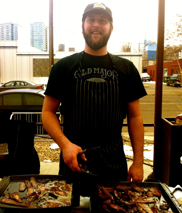 When you go to bacon and beer breakfast, you know you are in for a great time, guaranteed. It's a bonus then when you come across a great beard to go along with  your bacon and beer. Met Casey, who was serving up tasty bacon from the Denver Bacon Company at the Denver Beer Company's beer and bacon breakfast on a recent gorgeous Saturday morning. Casey, who is the Chef De Cuisine at Masterpiece Delicatessen in Denver, has had this beard for teh past seven years. Casey's called Denver home the past nine years, and originally hails from the Cedar Rapids, Iowa area (thus the love of bacon is not surprising). We liked Casey even more when he told us he hasn't been clean shaven since he was 19 years old--start man. Casey's sweetheart loves his beard (wise woman) and his two brothers also have the ability to sport beards, but don't always keep them--mayabe they'll be more encouraged now!