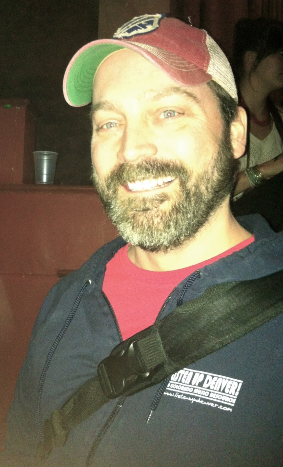 The ladies of Beards of Denver love catching live music in town, and recently when waiting to see the amazing band Pickwick play at the Bluebird theatre, we were lucky enough to meet Tim and admire his fantastic beard. Tim was not only at the show to enjoy the music, he was also covering it for the wonderful music website Listen Up Denver! TIm has been in Colorado 13 years, the past 10 in Denver, and he has also kept his beard the past 10 years (we, of course, think the correlation of beard growth and Denver residence is more than just a coincidence!) Tim's wife loves his beard, as does their seven week old daughter, Story. Already such good taste at such a young age! Tim and his beard also are contributing to building the local music scene in Denver; he helps organize the Soulfax Sessions at Park House, which are weekly free music nights on Thursdays at Park House. Be sure to check that out and say hi to Tim while you're at it!