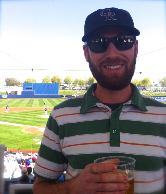 When the ladies of Beards of Denver headed down to Scottsdale, Arizona to catch some of the Colorado Rockies' spring training games, we were pleasantly surprised to also catch a great beard from (where else?) Denver! Meet Jeff, who we encountered at a Rockies vs. Brewers game on a sunny Sunday in Phoenix. Jeff's lovely wife Erica is a big fan of his beard; he usually shaves during baseball season, but with her encouraging he's likely to keep his beard all season long (it's sure to be the Rockies good luck charm, we're certain). Jeff and Erica live in HIghlands and will definitely be attending Opening Day this coming Friday. Jeff's favorite part of his beard is the beautiful girl it got him, and Erica says all her girlfriends admire Jeff's beard, too. Obviously, we like that those ladies share such good taste!
