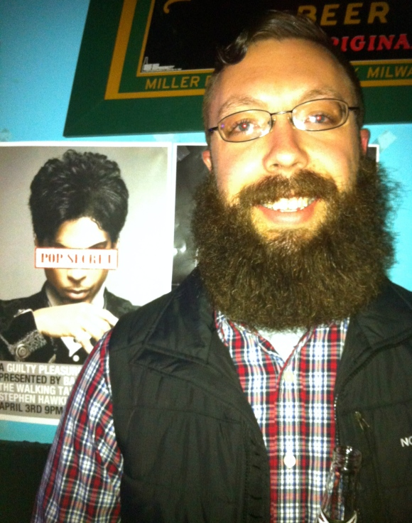When one thinks indie rock and beards in the same vein, a hipster-esque beard may first come to mind, but at the recent Phosphorescent show at the Hi-Dive in Denver, we met Sean and he proved that men with incredibly burly beards also love the alt-rock. Sean's a recent transplant to the Denver area from Reno, arriving just over a year ago. When he got out of the Marines he decided to go three months without shaving—and his current beard has surpassed the seven month mark—and we certainly hope his beard makes it a full year! When asked what his family thinks of his beard, he says his dad (who is also a former Marine) is somewhat skeptical; obviously we need to send him this amazing photo to prove to him how fantastic Sean's beard really is! Sean—who's currently single, ladies—said his ex wasn't a huge fan of his beard, which we can't fully comprehend; we will happily admire such beard genius!