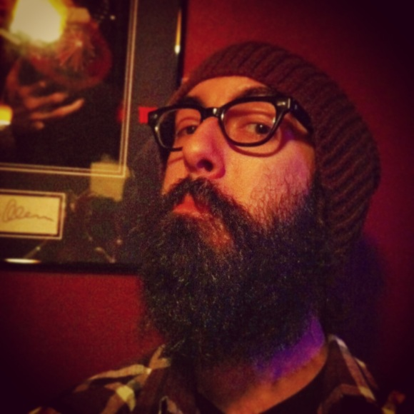 "We've got a special guest beard to make your Memorial Day weekend that much more memorable! Meet Anthony! Half of B of D was on the hunt in NYC this past week and happened upon this bearded gem at an underground comedy show. This beard will make your belly laugh and your ears ache for more of his sweet, sweet tunes. His current beard is only 6 months old. Favorite part? He doesn't like to shave. What?!?!? He treats his facial hair to a shampoo and conditioning treatment every day---you know what they say, a man with a well kept beard also knows how to treat a lady! When asked what mama thinks, he said ""she thinks it looks fine"" (and with the same amount of emotion that you'd imagined). Last time his face was naked was over 4 years ago, just for the hell of it. Check out his work at www.anthonykapfer.com You'll be glad you did! Hopefully we can convince Sir Anthony to take his show on the road and head to Denver!"