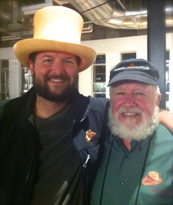 Who knew spirits and beards went so well together?  The ladies of Beards of Denver, that's who.  A few months back at the D-Still spirit-tasting event in Denver (during the American Distilling Institute conference), we were lucky enough to happen upon Gary Hinegardner and his son Jeremy and their amazing father/son beards' combo. The elder Hinegardner, who lives in Montgomery City, Missouri, with his wife, Katy, dabbles in making spirits (gin, whiskey, and vodka) and also makes the impressive wooden hats they're modeling here.  Jeremy, who has called Boulder home since 2000, runs his own company called Copious Free Time, where he helps people solve complex technology problems. Jeremy used to only have a goatee (for shame) and after attending a conference in Ireland last year (where attendees were asked to grow out their beards) he smartly decided to stay on the beard-path.  Gary has had a beard or 'stache most of his adult life (wise man indeed). Gary was a wood turner for a long time before he decided to learn how to make wooden hats, and now, spirits. His distillery is in New Florence, Missouri and he plans to let his beard continue to grow as he pursues his new passion.   http://woodhatspirits.com and http://facebook.com/woodhatspirits).