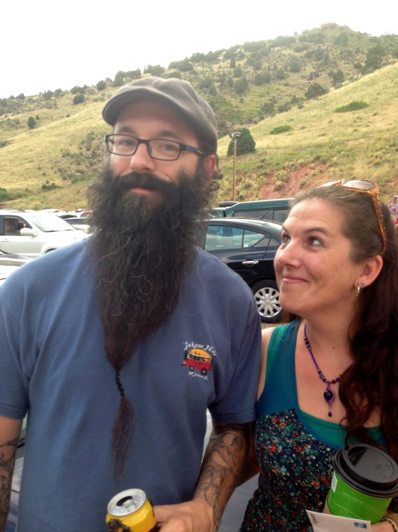 As fans of Beards of Denver may not be surprised to learn, Red Rocks is one of the meccas of spotting epic beards. But when we saw Sean tailgating before the Avett Brothers show recently, we knew we'd spotted a bearded diamond in the rough. Sean, who lives in Colorado Springs and is a tattoo artist at Nostalgia Tattoo Co. there, not only can obviously grow an impressive beard, he has used his stunning handsomeness to his advantage, trying out to be a beard model in Bend, Oregon after he had heard about European Beard Models (that sounds like a trip we need to take!) Sean, who's a huge Colorado Avalanche fan, told us he and many others specifically will grow out their beards when the Stanley Cup starts, which seems like as good a reason as any for showing off that rad facial hair. When we asked Sean's lovely sweetheart Mandy if she was a fan of his beard, she noted she couldn't imagine him without it, since he's had it the entire three years of their courtship. She did say though that sometimes she grabs his beard at night instead of a blanket, which really seems like a better thing to nuzzle up in anyway! Also, apparently Sean and Mandy's cats aren't afraid to nuzzle right up in all that bearded-fierce-fantasticness, either! Obviously, they recognize. Thanks Sean! Keep up that great beard work.